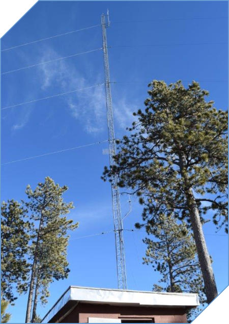 Image of a radio tower at a mountain top                           repeater site